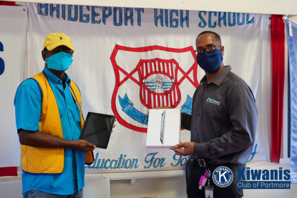 Donovan Morgan Managing Director of Epic Technologies handing over tablet at Bridgeport High School